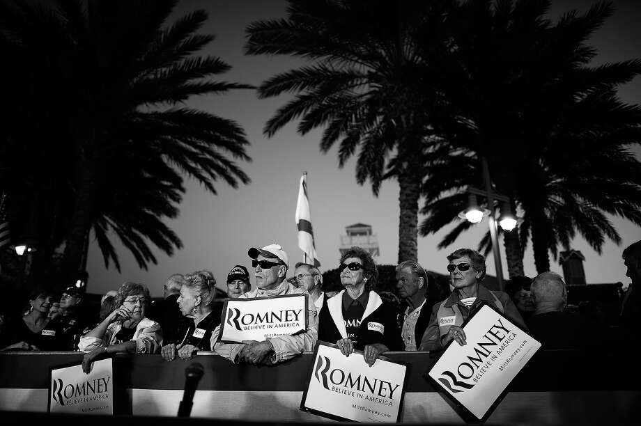 BLACK AND WHITE VERSION - Republican presidential hopeful Mitt Romney supporters await his arrival at a campaign rally at Lake Sumter Landing in The Villages, Florida, January 30, 2012. Florida will hold its Republican primary on January 31, 2012. AFP PHOTO/Emmanuel Dunand        (Photo credit should read EMMANUEL DUNAND/AFP/GettyImages) Photo: EMMANUEL DUNAND, AFP/Getty Images / 2012 AFP