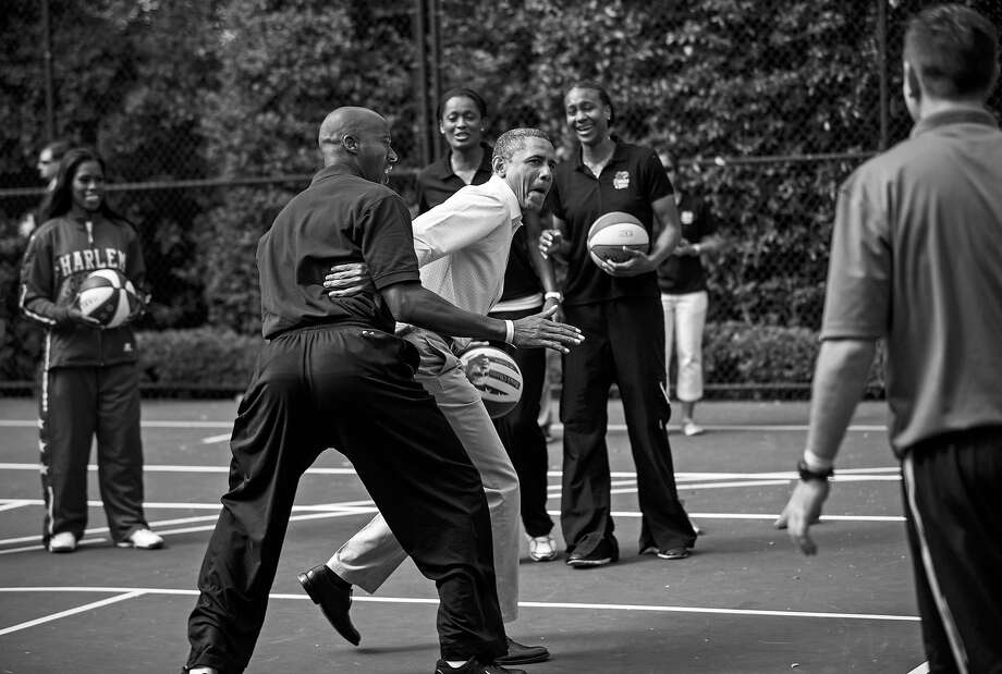 BLACK AND WHITE VERSION - US President Barack Obama plays basketball with former NBA player Bruce Bowen during the annual Easter Egg Roll on the South Lawn of the White House April 9, 2012 in Washington, DC.  The First Family participated in the yearly event where the South Lawn is opened up to guests to participate in various egg rolls and other activities.  AFP PHOTO/Brendan SMIALOWSKI        (Photo credit should read BRENDAN SMIALOWSKI/AFP/GettyImages) Photo: BRENDAN SMIALOWSKI, AFP/Getty Images / 2012 AFP