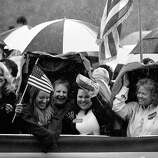 BLACK AND WHITE VERSION - Republican presidential hopeful Mitt Romney supporters await his arrival under rain at a campaign rally in Gilbert, South Carolina, January 20, 2012. South Carolina will hold its Republican primary on January 21, 2012.  AFP PHOTO/Emmanuel Dunand        (Photo credit should read EMMANUEL DUNAND/AFP/GettyImages)