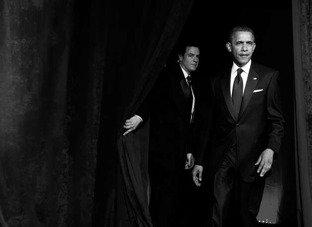 BLACK AND WHITE VERSION - US President Barack Obama arrives to speak at the Asian Pacific American Institute for Congressional Studies (APAICS) 18th Annual Gala Dinner in Washington on May 8, 2012.    AFP PHOTO/Saul LOEB        (Photo credit should read SAUL LOEB/AFP/GettyImages) Photo: SAUL LOEB, AFP/Getty Images / 2012 AFP
