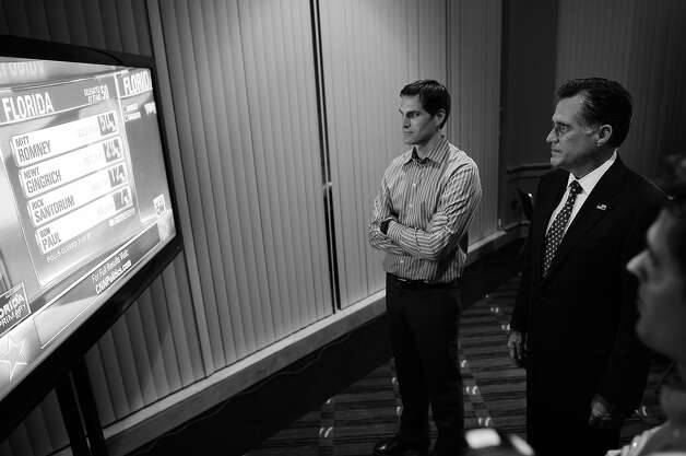 BLACK AND WHITE VERSION - Republican presidential hopeful Mitt Romney (R) watches primary election resukts with his son Josh during a primary election night event in Tampa, Florida, January 31, 2012.   AFP PHOTO/Emmanuel Dunand        (Photo credit should read EMMANUEL DUNAND/AFP/GettyImages) Photo: EMMANUEL DUNAND, AFP/Getty Images / 2012 AFP