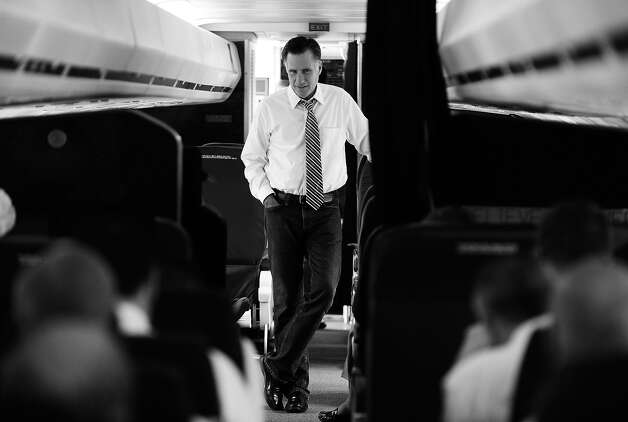 BLACK AND WHITE VERSION - US Republican presidential candidate Mitt Romney chats with his advisers on board his campaign plane on October 4, 2012 in Denver, Colorado. AFP PHOTO/Jewel Samad        (Photo credit should read JEWEL SAMAD/AFP/GettyImages) Photo: JEWEL SAMAD, AFP/Getty Images / 2012 AFP