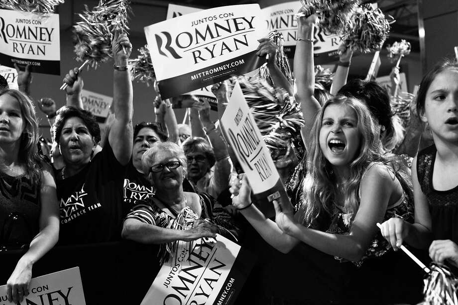 BLACK AND WHITE VERSION - Supporters cheers for US Republican presidential candidate Mitt Romney at a campaign rally in Miami on September 19, 2012.   AFP PHOTO/Nicholas KAMM        (Photo credit should read NICHOLAS KAMM/AFP/GettyImages) Photo: NICHOLAS KAMM, AFP/Getty Images / 2012 AFP