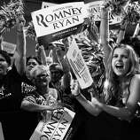 BLACK AND WHITE VERSION - Supporters cheers for US Republican presidential candidate Mitt Romney at a campaign rally in Miami on September 19, 2012.   AFP PHOTO/Nicholas KAMM        (Photo credit should read NICHOLAS KAMM/AFP/GettyImages)