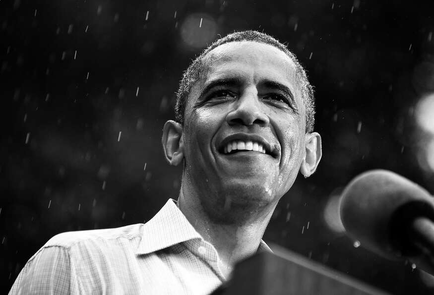 BLACK AND WHITE VERSION - US President Barack Obama speaks during a rain-soaked campaign event July