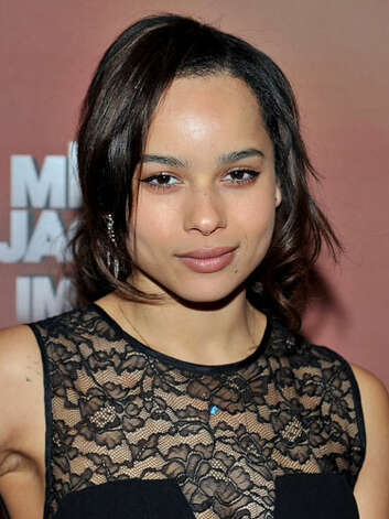 Zoe Kravitz Zoe takes a less dramatic approach at an event in 2012, wearing a delicate lace frock, soft pink makeup, with loose tendrils of hair framing her face. She still oozes coolness, but her new toned-down look lets her really show off those good genes.   Reprinted with Permission of Hearst Communications, Inc. Originally Published: 60 Best Celebrity Makeovers of All Time Photo: Getty Images / 2012 Getty Images