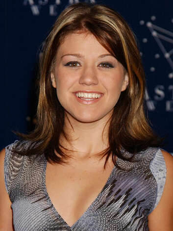 Kelly Clarkson Just after her big American Idol win in 2002, Kelly Clarkson still looks like an average college girl with blonde-streaked, shoulder-length hair, and glossy lips.  Reprinted with Permission of Hearst Communications, Inc. Originally Published: 60 Best Celebrity Makeovers of All Time Photo: Getty Images / WireImage
