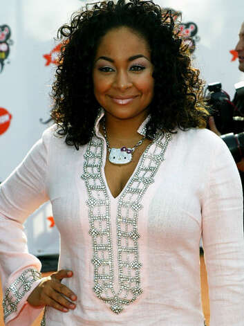 "Raven Symoné With her bedazzled top, Hello Kitty necklace, curly hair, and pink eye shadow, Raven didn't subscribe to the ""less is more"" theory at the Kids Choice Awards in 2008.  Reprinted with Permission of Hearst Communications, Inc. Originally Published: 60 Best Celebrity Makeovers of All Time Photo: Getty Images / 2005 Getty Images"