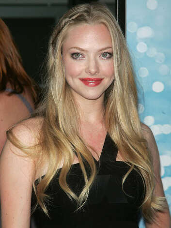 Amanda Seyfried Amanda was every bit the girl next door back in 2008. Her extra-long locks and subtle lip color make her-oh-so approachable at the premiere of her breakout film Mamma Mia.  Reprinted with Permission of Hearst Communications, Inc. Originally Published: 60 Best Celebrity Makeovers of All Time Photo: Getty Images / 2008 Jim Spellman