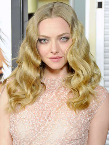 Amanda Seyfried Amanda's gone from sweet to sultry in just a few years: At the 2012 premiere of Gone she dons seductive smoky eye makeup and voluminous curls. An Old Hollywood aesthetic definitely suits this fair-skinned beauty.  Reprinted with Permission of Hearst Communications, Inc. Originally Published: 60 Best Celebrity Makeovers of All Time Photo: Getty Images / 2012 Barry King