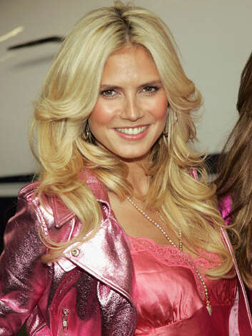 Heidi Klum Nothing says Victoria's Secret model like Heidi's blonde bombshell waves, hoop earrings and sparkling pink moto jacket at the kick off of the Angels Across America tour in 2004.    Reprinted with Permission of Hearst Communications, Inc. Originally Published: 60 Best Celebrity Makeovers of All Time Photo: Getty Images / 2004 Getty Images