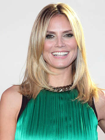 Heidi Klum Heidi has definitely learned a few styling tips as host of Project Runway. Her chic layers, luscious lashes and chain-detailed top at the 10th anniversary of the show in 2012 are so much more fashion-forward.  Reprinted with Permission of Hearst Communications, Inc. Originally Published: 60 Best Celebrity Makeovers of All Time Photo: Getty Images / 2012 Rob Kim