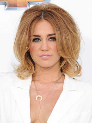 Miley Cyrus Newly-engaged Miley's bouffant bob and bold brows at the 2012 Billboard Music Awards give her a classic look to match her more mature relationship status. But even though she's saying goodbye to being single, she's still keeping that nose ring.   Reprinted with Permission of Hearst Communications, Inc. Originally Published: 60 Best Celebrity Makeovers of All Time Photo: Getty Images / 2012 Jon Kopaloff
