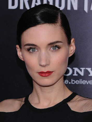 Rooney Mara Rooney has gone to the dark side at the The Girl with the Dragon Tattoo premiere. Her new inky cut and red lips are full of naughty sex appeal.  Reprinted with Permission of Hearst Communications, Inc. Originally Published: 60 Best Celebrity Makeovers of All Time Photo: Getty Images