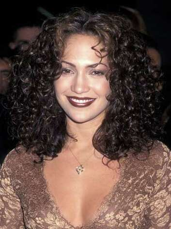 Jennifer Lopez Jenny from the Block was a brunette with bouncing curls at the 1997 premiere of Anaconda. The dark lip color was a temporary blunder for the dancer-turned-singer-turned-actress.  Reprinted with Permission of Hearst Communications, Inc. Originally Published: 60 Best Celebrity Makeovers of All Time Photo: Getty Images / 1997 Ron Galella, Ltd.