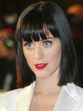 Katy Perry When it comes to her hair, Katy Perry has wandered the color spectrum from blue to pink. Here she is wearing a reserved black bob with a blunt bang at the 2009 Palais des Festivals in Cannes. But her bright lip color and stand-out lashes still grab attention.  Reprinted with Permission of Hearst Communications, Inc. Originally Published: 60 Best Celebrity Makeovers of All Time Photo: Getty Images / 2009 AFP