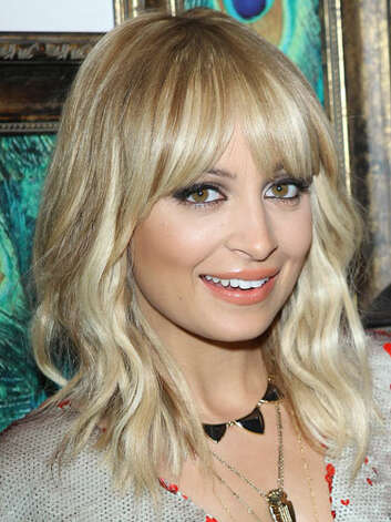 Nicole Richie Now, Nicole has come into her socialite persona and rocks a demure blonde bob with bangs at her House of Harlow 1960 holiday pop-up shop.  Reprinted with Permission of Hearst Communications, Inc. Originally Published: 60 Best Celebrity Makeovers of All Time Photo: Getty Images