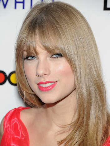 Taylor Swift Taylor has opted to darken her tresses, straighten her natural curls, and cut her bangs. Attending Billboard's 2011 Women in Music event she also swiped on her favorite red lipstick which fans have come to expect in her red carpet looks.  Reprinted with Permission of Hearst Communications, Inc. Originally Published: 60 Best Celebrity Makeovers of All Time Photo: Getty Images