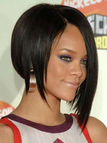 Rihanna Rihanna had hairstylists everywhere cutting their clients into an asymmetrical bob as seen here at the 2007 Nickelodeon Kids' Choice Awards.  Reprinted with Permission of Hearst Communications, Inc. Originally Published: 60 Best Celebrity Makeovers of All Time Photo: Getty Images