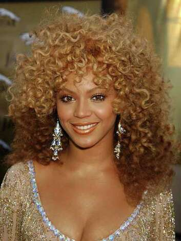 Beyoncé Knowles These two-toned, bodacious curls are more than we can handle on Beyoncé at the 2002 Austin Powers in Goldmember premiere. She was definitely channeling the Foxy Cleopatra of the '70s.  Reprinted with Permission of Hearst Communications, Inc. Originally Published: 60 Best Celebrity Makeovers of All Time Photo: Getty Images
