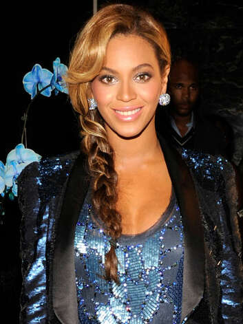 Beyoncé Knowles At the 2011 launch of her fragrance, Pulse, this braided style suits the superstar's on-the-go lifestyle and will be much easier to manage with a baby in tow! Beyoncé still loves to sparkle in her sequins ensemble.  Reprinted with Permission of Hearst Communications, Inc. Originally Published: 60 Best Celebrity Makeovers of All Time Photo: Getty Images