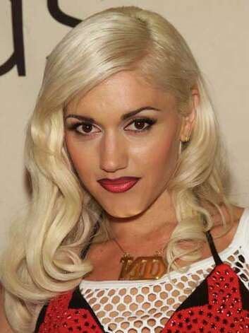 Gwen Stefani As a member of No Doubt, Gwen had a punk image to uphold with her mesh tank layered with a bikini top and an oversized gold chain at the 2001 VH1 Vogue Fashion Awards.  Reprinted with Permission of Hearst Communications, Inc. Originally Published: 60 Best Celebrity Makeovers of All Time Photo: Getty Images