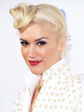 Gwen Stefani Now, Gwen's business is fashion.  She stays true to her rocker style with gold accents and an askew top knot hairstyle at the In the Land of Blood and Honey premiere in Los Angeles.  Reprinted with Permission of Hearst Communications, Inc. Originally Published: 60 Best Celebrity Makeovers of All Time Photo: Getty Images