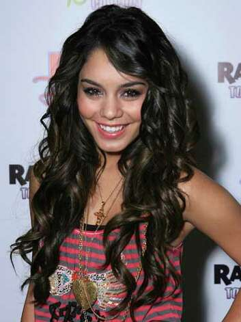 Vanessa Hudgens The teeny bopper style that Vanessa portrayed in High School Musical lives on at the Radio Disney Totally 10 Birthday Concert where she wears layered necklaces, a black-tipped mani, and long beach waves.  Reprinted with Permission of Hearst Communications, Inc. Originally Published: 60 Best Celebrity Makeovers of All Time Photo: Getty Images