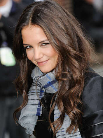 Katie Holmes At a 2011 taping of the Late Show With David Letterman, Katie wears her long waves with style and has grown into her new family gal image while keeping her wholesome sex appeal.  Reprinted with Permission of Hearst Communications, Inc. Originally Published: 60 Best Celebrity Makeovers of All Time Photo: Getty Images
