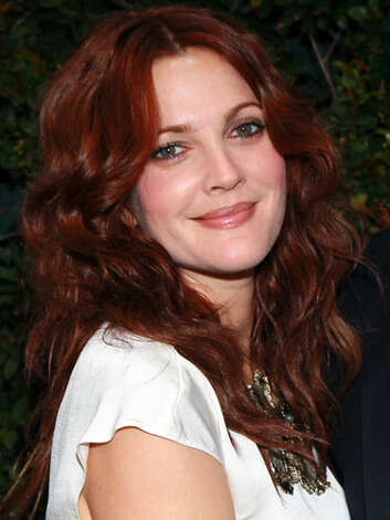 Drew Barrymore Drew is sporting a brazen red dye that really makes her fair features and bright eyes simmer at a 2011 benefit dinner hoted by Chanel.  Reprinted with Permission of Hearst Communications, Inc. Originally Published: 60 Best Celebrity Makeovers of All Time Photo: Getty Images