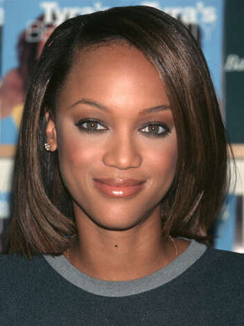 Tyra Banks At this 1998 signing for her book,Tyra's Beauty Inside and Out, Tyra sports a textbook bob hairstyle and very little makeup which allows her natural beauty to shine.  Reprinted with Permission of Hearst Communications, Inc. Originally Published: 60 Best Celebrity Makeovers of All Time Photo: Getty Images