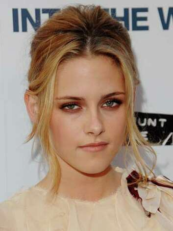 Kristen Stewart Kristen went blonde in 2007 at the Into the Wild premiere. Her light hair doesn't quite complement her brooding blue eyes like the brunette strands hat are peeking out at the roots.  Reprinted with Permission of Hearst Communications, Inc. Originally Published: 60 Best Celebrity Makeovers of All Time Photo: Getty Images / 2007 Jon Kopaloff