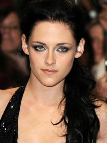 Kristen Stewart At the premiere of The Twilight Saga: Breaking Dawn Part 1, Kristen has surpassed her brown locks and taken her look to darker black depths.  Reprinted with Permission of Hearst Communications, Inc. Originally Published: 60 Best Celebrity Makeovers of All Time Photo: Getty Images