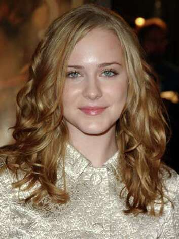 Evan Rachel Wood At the 2003 The Last Samurai premiere, Evan is stuck in the past wearing a conservative jacket and curls that mimics the style of Jackie O.  Reprinted with Permission of Hearst Communications, Inc. Originally Published: 60 Best Celebrity Makeovers of All Time Photo: Getty Images