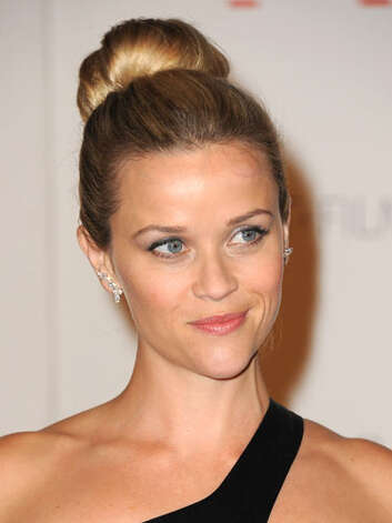 Reese Witherspoon The high chignon is a testament to Reese's new big girl persona at the LACMA Art + Film Gala. However she isn't afraid to show a little skin with this one shoulder ensemble.  Reprinted with Permission of Hearst Communications, Inc. Originally Published: 60 Best Celebrity Makeovers of All Time Photo: Getty Images