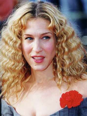 Sarah Jessica Parker SJP's hair is more frizz than fashionable at the 2000 SAG Awards. This look reminds us of the teasing and crimping of the '80s.  Reprinted with Permission of Hearst Communications, Inc. Originally Published: 60 Best Celebrity Makeovers of All Time Photo: Getty Images