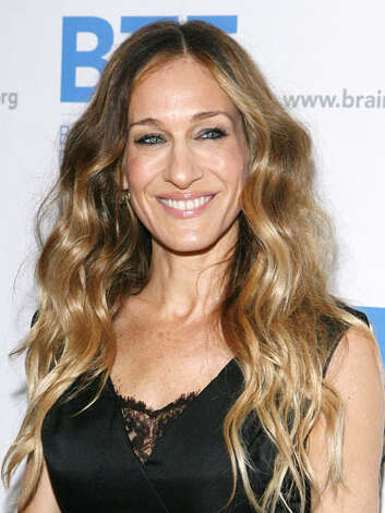 Sarah Jessica Parker This long wavy hairstyle at the 2011 Brain Trauma Foundation Gala is more becoming for a woman of Sarah's stature. She is a knock-out with just a hint of lace to add sex appeal.  Reprinted with Permission of Hearst Communications, Inc. Originally Published: 60 Best Celebrity Makeovers of All Time Photo: Getty Images