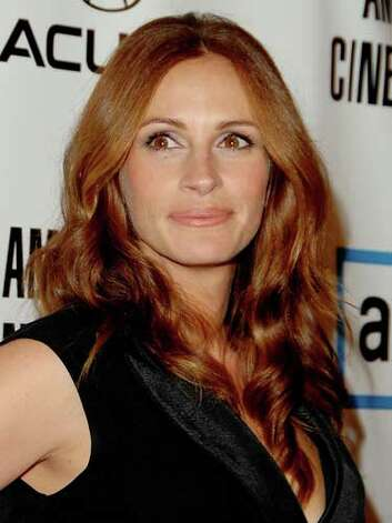 Julia Roberts We loved Julia's flowing red mane that makes her eyes pop and her fair skin glisten at the American Cinematique Honors in 2007.  Reprinted with Permission of Hearst Communications, Inc. Originally Published: 60 Best Celebrity Makeovers of All Time Photo: Getty Images / 2007 Jon Kopaloff