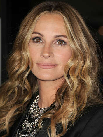 Julia Roberts At the premiere of  Fireflies in the Garden, Julia has brightened up her look with a blonde highlighted hue that is just as flattering as her previous red locks. She looks good in any hair color.  Reprinted with Permission of Hearst Communications, Inc. Originally Published: 60 Best Celebrity Makeovers of All Time Photo: Getty Images