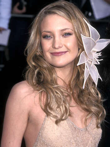 Kate Hudson Whimsical is the best word to describe the fashion sense of Kate at the 2001 Screen Actors Guild Awards. Her oversized flower, waves, and sheer dress make it clear that she is the daughter of a hippie.  Reprinted with Permission of Hearst Communications, Inc. Originally Published: 60 Best Celebrity Makeovers of All Time Photo: Getty Images