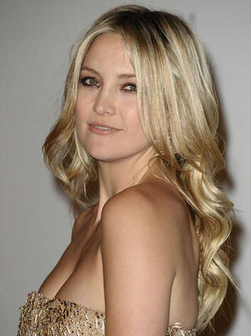 Kate Hudson Kate's golden attire matches her bright locks at the LACMA Art + Film Gala. Plus, motherhood has done wondrous things for the starlet's cleavage.  Reprinted with Permission of Hearst Communications, Inc. Originally Published: 60 Best Celebrity Makeovers of All Time Photo: Getty Images
