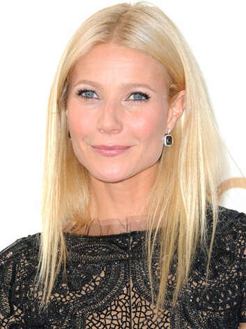 Gwyneth Paltrow Gone are the dark days for Gwen. At the 2011 Emmy Awards she chose a dainty lace ensemble with straight blonde strands and a center part.  Reprinted with Permission of Hearst Communications, Inc. Originally Published: 60 Best Celebrity Makeovers of All Time Photo: Getty Images