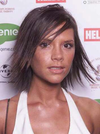 Victoria Beckham Posh Spice sports an awkward smile to match her equally stiff strands that have been electrified by a flat iron and hairspray at the 2001 Silver Chef Awards.  Reprinted with Permission of Hearst Communications, Inc. Originally Published: 60 Best Celebrity Makeovers of All Time Photo: Getty Images / 2001 Getty Images