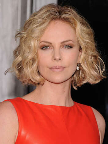 Charlize Theron Seen at the premiere of her film Young Adult, Charlize has lightened up her style. Her natural makeup and bright attire complement her short blonde waves.  Reprinted with Permission of Hearst Communications, Inc. Originally Published: 60 Best Celebrity Makeovers of All Time Photo: Getty Images