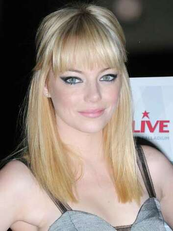 "Emma Stone Emma Stone unveiled her blonde bombshell remodel at the ""Trevor LIVE"" Benefit Gala in 2010. Even though we love the bangs, we aren't too sure this hair color goes best with her freckles and quirky personality.  Reprinted with Permission of Hearst Communications, Inc. Originally Published: 60 Best Celebrity Makeovers of All Time Photo: Getty Images / 2010 Barry King"