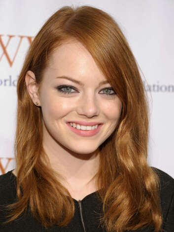 Emma Stone At the 2011 Worldwide Orphans Foundation's Benefit Gala, our favorite redhead was back to her blazing mane that is brighter than ever.  Reprinted with Permission of Hearst Communications, Inc. Originally Published: 60 Best Celebrity Makeovers of All Time Photo: Getty Images
