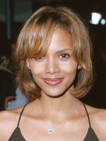 Halle Berry This sex symbol wasn't always so sensual. Halle's caramel bob with sideswept bangs at the 1999 premiere of Life are anything but flattering.  Reprinted with Permission of Hearst Communications, Inc. Originally Published: 60 Best Celebrity Makeovers of All Time Photo: Getty Images