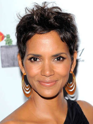 Halle Berry After a stint wearing her hair in her long natural curls, Halle is back to her signature pixie cut at the 2011 FiFi Awards. This hairstyle really allows her best features to shine.  Reprinted with Permission of Hearst Communications, Inc. Originally Published: 60 Best Celebrity Makeovers of All Time Photo: Getty Images
