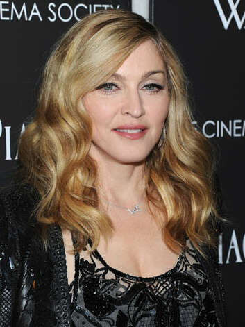 Madonna Seen at the screening of W.E. in New York, Madonna looks like the music icon that she has become with bouncing waves and a muted pink lip.  Reprinted with Permission of Hearst Communications, Inc. Originally Published: 60 Best Celebrity Makeovers of All Time Photo: Getty Images