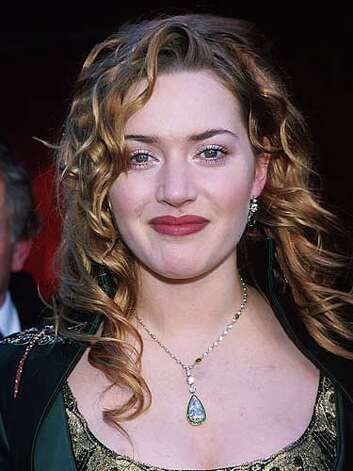 Kate Winslet Kate's fair skin pales in comparison to her long auburn curls, emerald dress and crimson lips at the 1998 Academy Awards red carpet.  Reprinted with Permission of Hearst Communications, Inc. Originally Published: 60 Best Celebrity Makeovers of All Time Photo: Getty Images